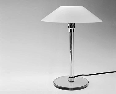 WA28:  1924  |                                      Wilhelm Wagenfeld                                      Table lamp with base in cut glass, shade in blown opaline glass. Max recommended 60w.
