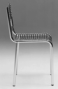HE14: 1928-30  |                                      René Herbst                                          Chair with chrome-plated tubular steel frame. Seat, back and arms in black elastic cords. Also available with lacquered frame.