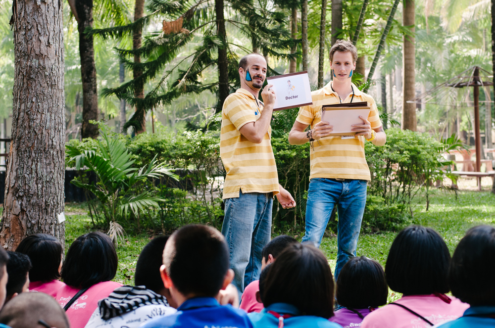 Jamie and Bart play charades at an English Camp in Pak Chong, Thailand.