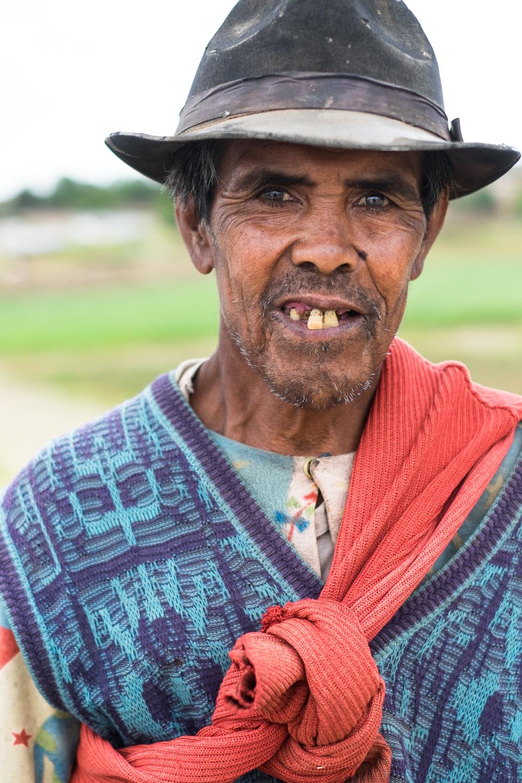 A portrait of a farmer in the fields near Antsirabe.