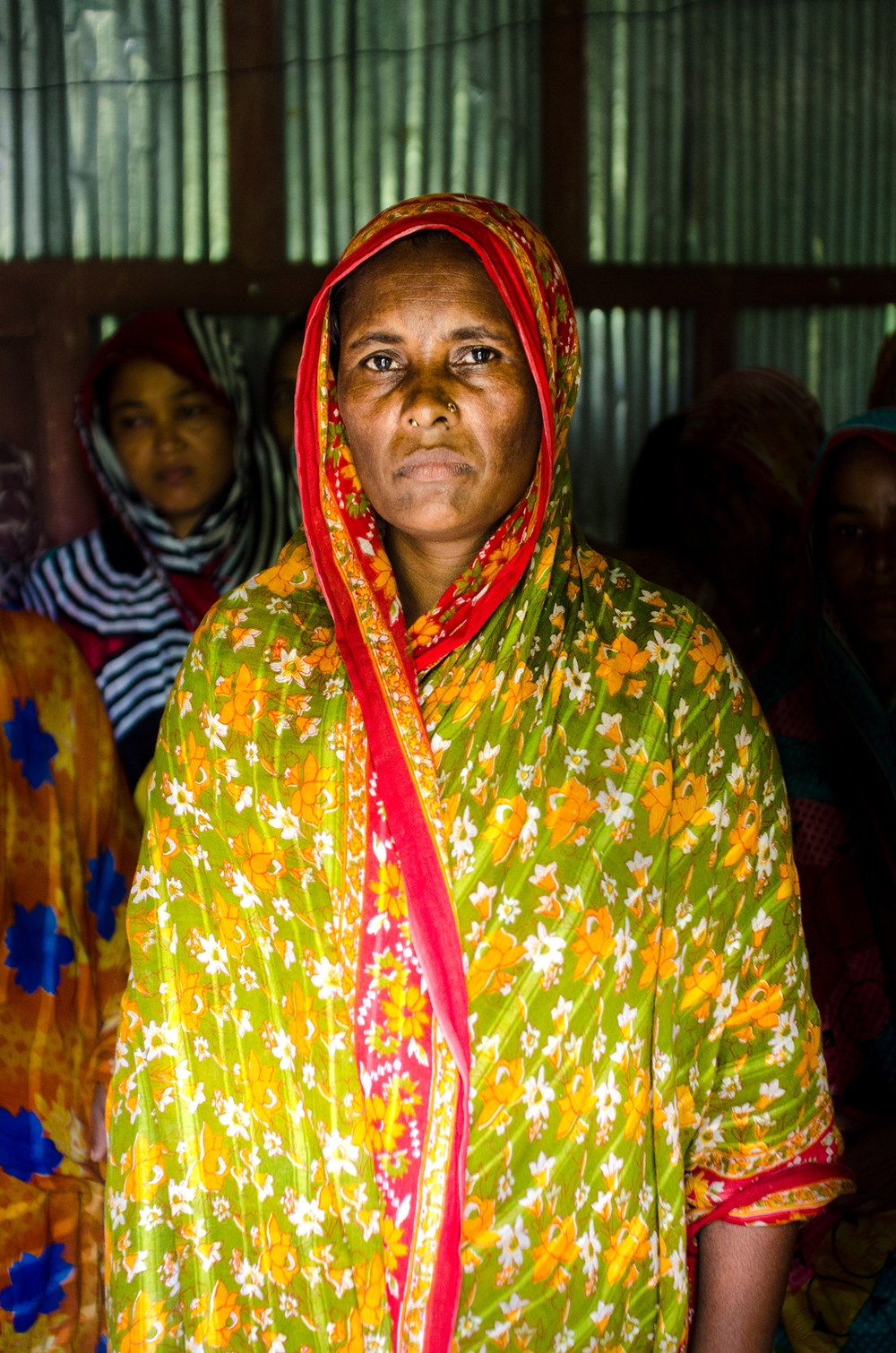 One of the landless women poses for a portrait. Noakhali, Bangladesh. 2013.