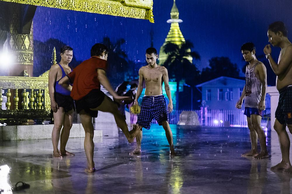 Men play Sepaw Takraw outside of the Shwedagon Pagoda. Yangon, Myanmar. 2015.