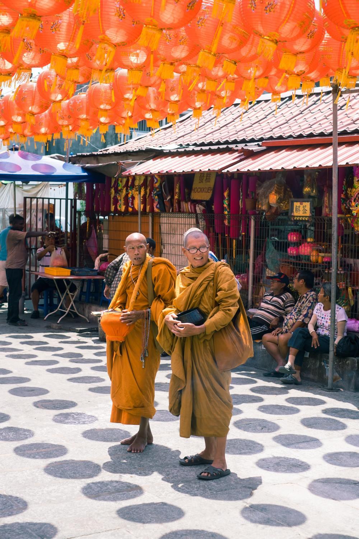 Monks outside a Buddhism Temple in Penang, Kuala Lumpur.