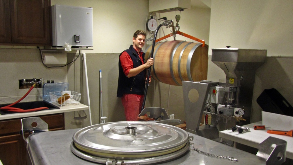 1 David Fenyvesi moving wine from barrel to mixing tank
