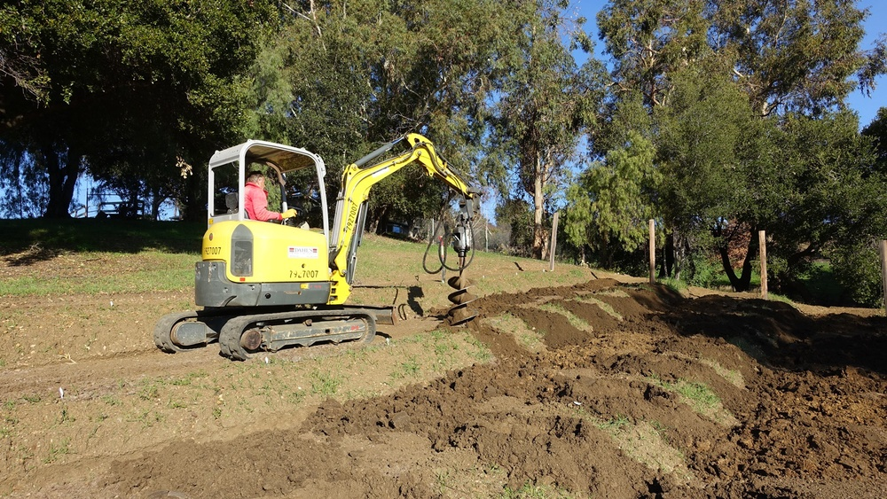 """4 Drill plant holes 18"""" x 4' with excavator"""