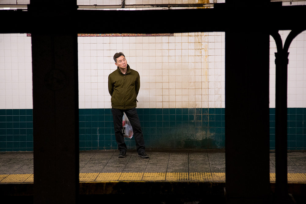 A man on a subway platform, NYC