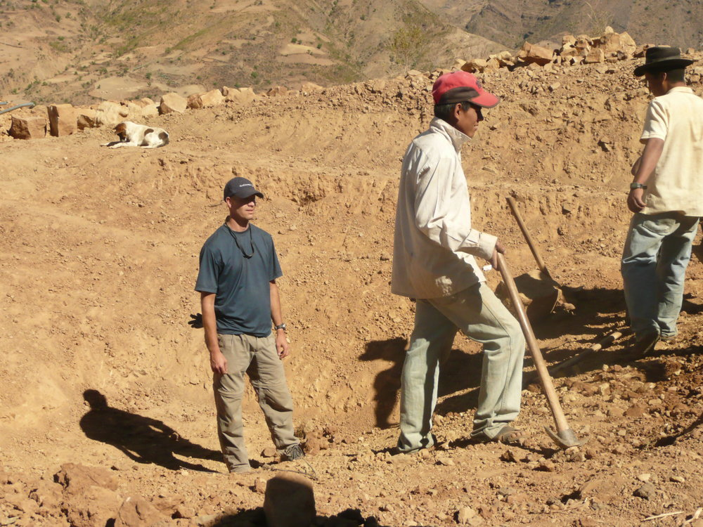 Dave Cook and local project team doing water supply work in Bolivia