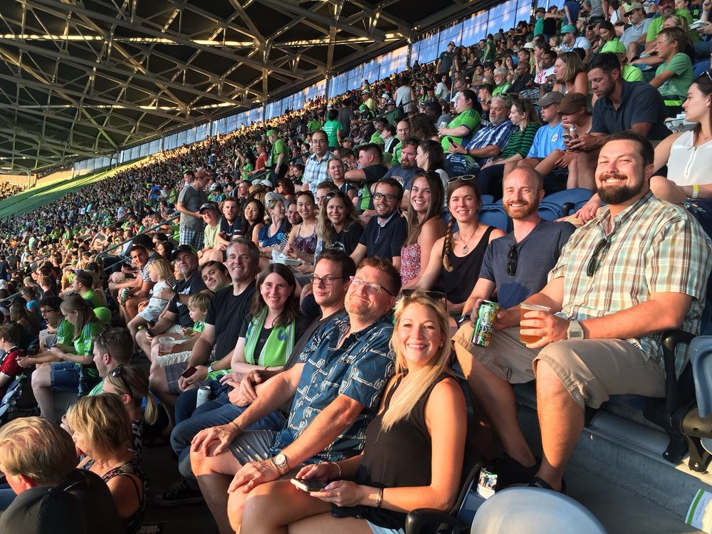 The Aspect crew catches the last rays of sun at the Sounders match