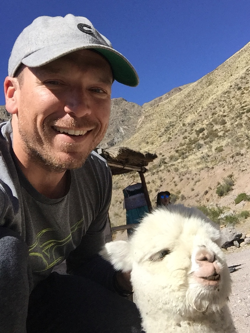 Chad and baby llama in Colca Canyon, Peru.