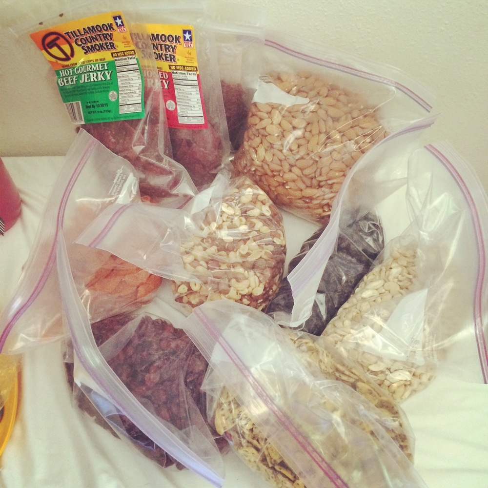 Road trip snacks. How long do you think this massive pile of nuts, dried fruit, and beef jerky will last?