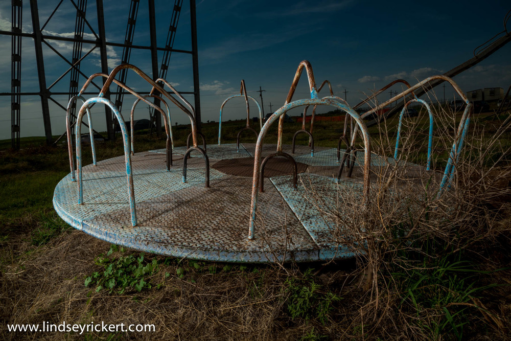 Abandoned playground equipment at abandoned Star-Vu Drive-In located in Anthony, Kansas