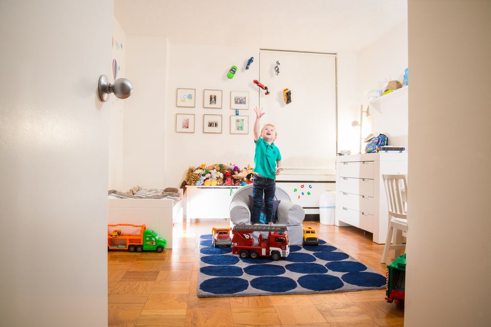I love this fantasy shoot I did for an amazing family in New York City. Lucas is, a 3 year old obsessed with trucks. To capture this stage in his life I creating a sneak peek into a magical fantasy land in his room where gravity was suspended and the wonder of life was explored.