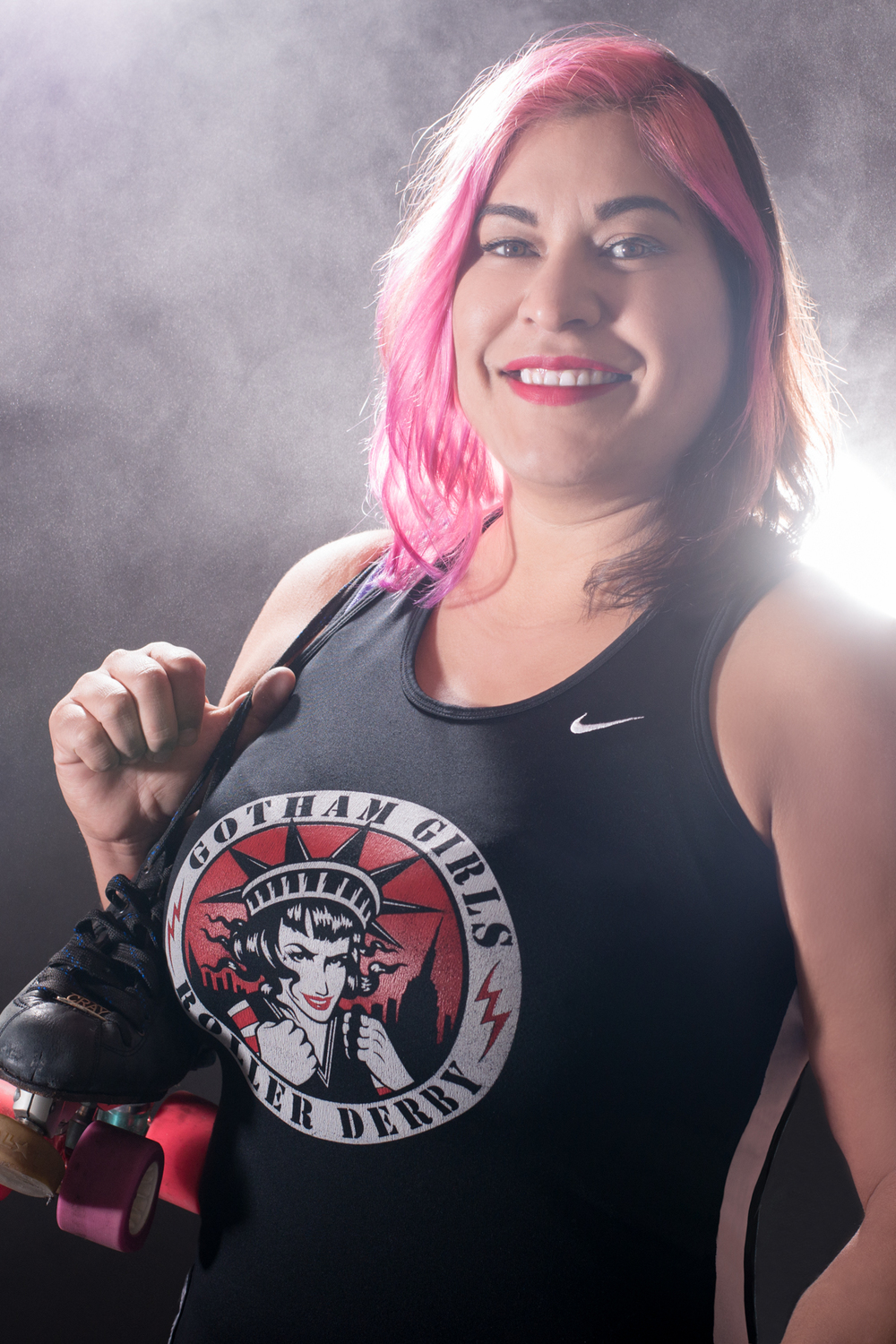 Back in January I had the pleasure of doing a portrait session with Team U.S.A. member and Gotham Roller Girls All-Star player, Mick Swagger. She wanted to create some strong athletic portraits to help launch her derby career move of switching from player to coach. For those of you who don't know, I was an original member of Portland's Rose City Roller. I played derby for 6 years and coached for 2 years so portraits like these always have a special place in my heart.