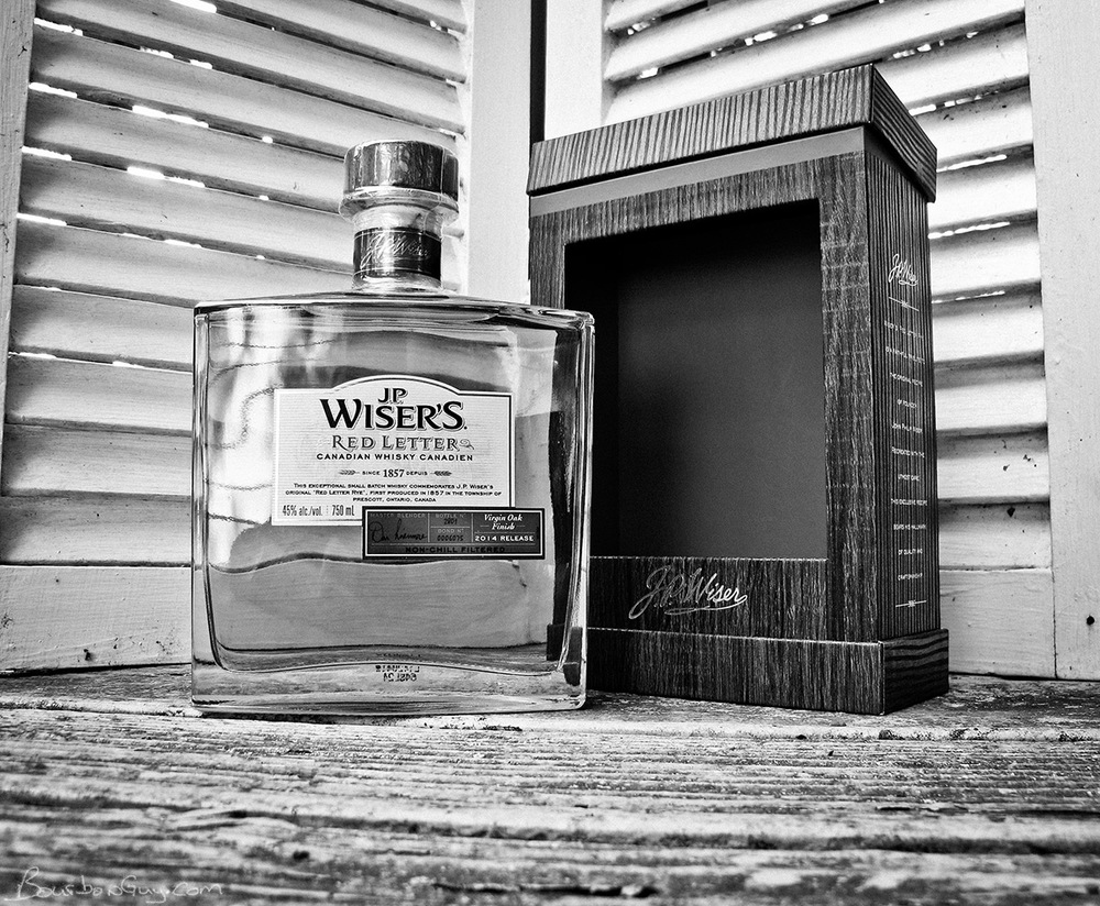 A bottle of Wiser's Red Letter Canadian Whisky and the box it comes in.