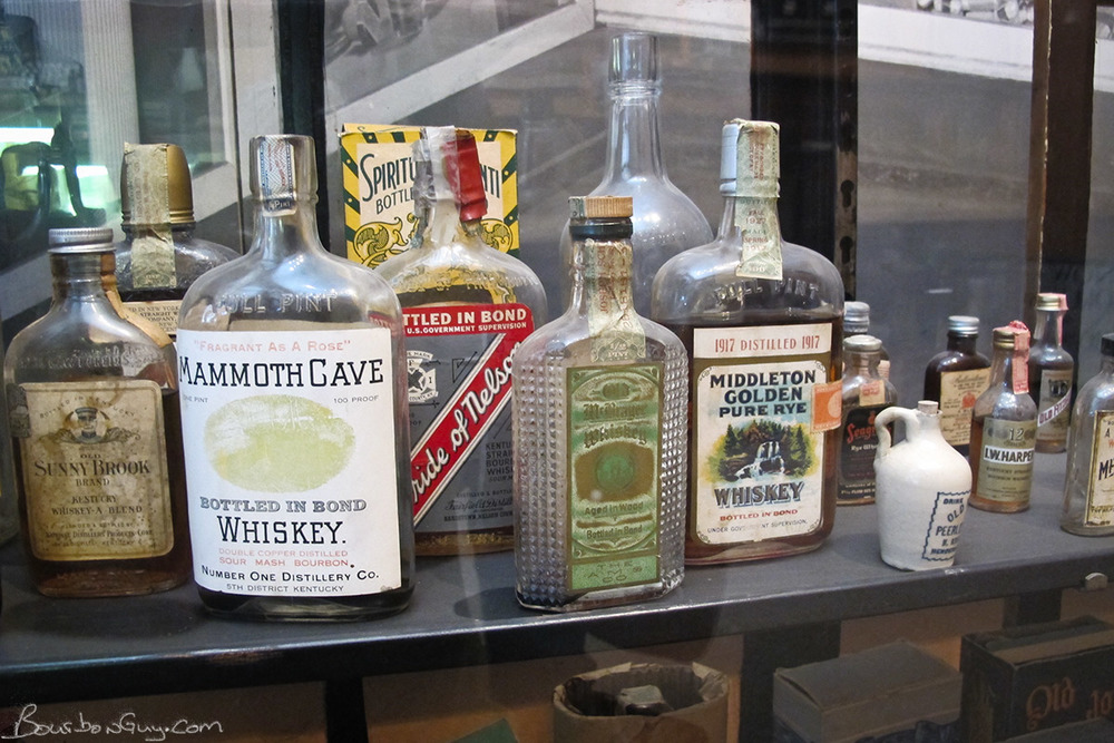 Old Whiskey bottles in a display case