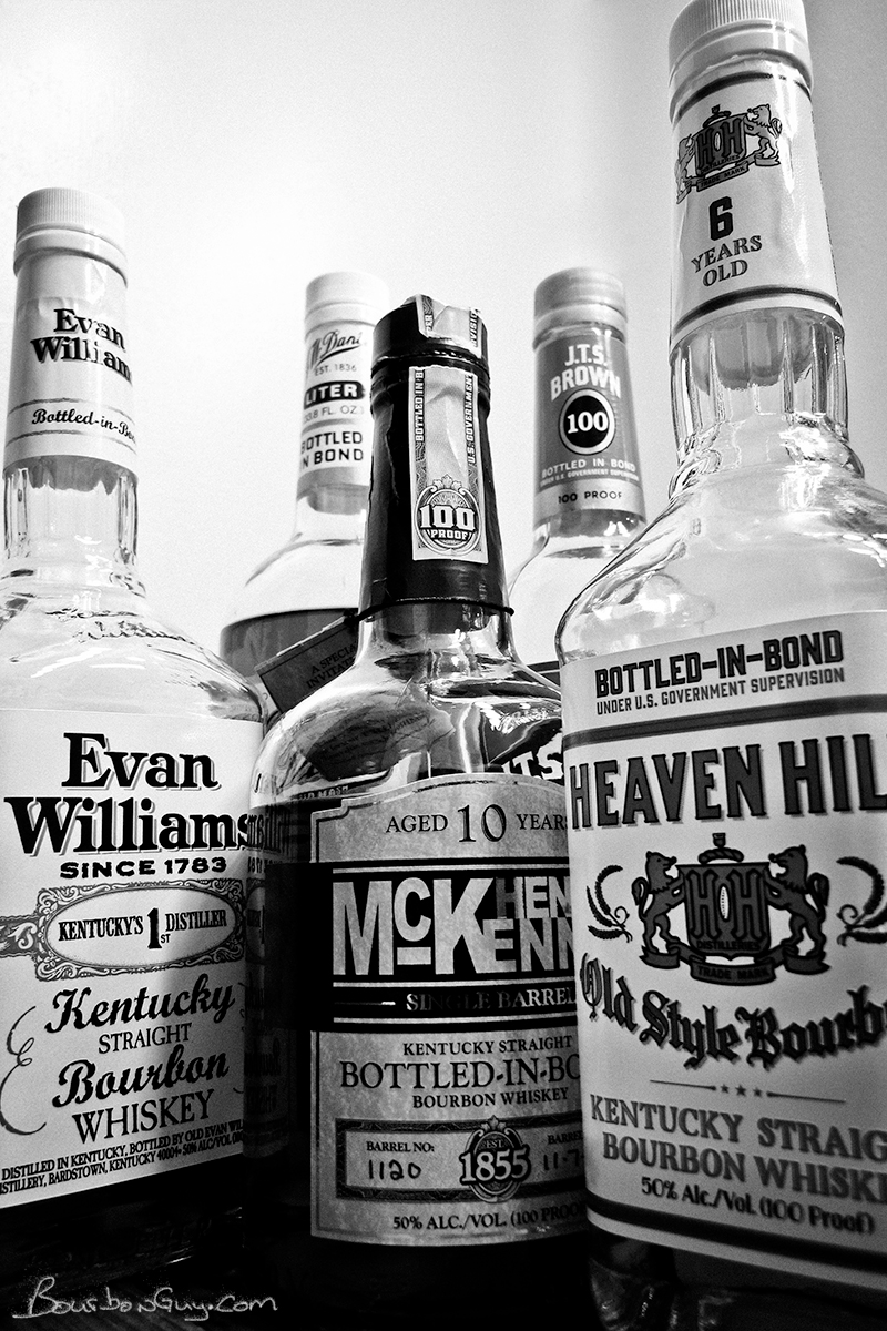 A partial line up of readily available Heaven Hill Bonded Bourbons. JW Dant, Evan Williams, Henry McKenna, JTS Brown and Heaven Hill white label.