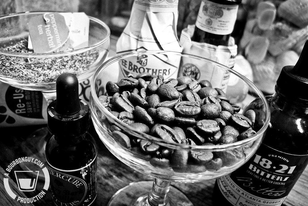 coffee beans in a coupe glass, herbal teas and cocktail bitters