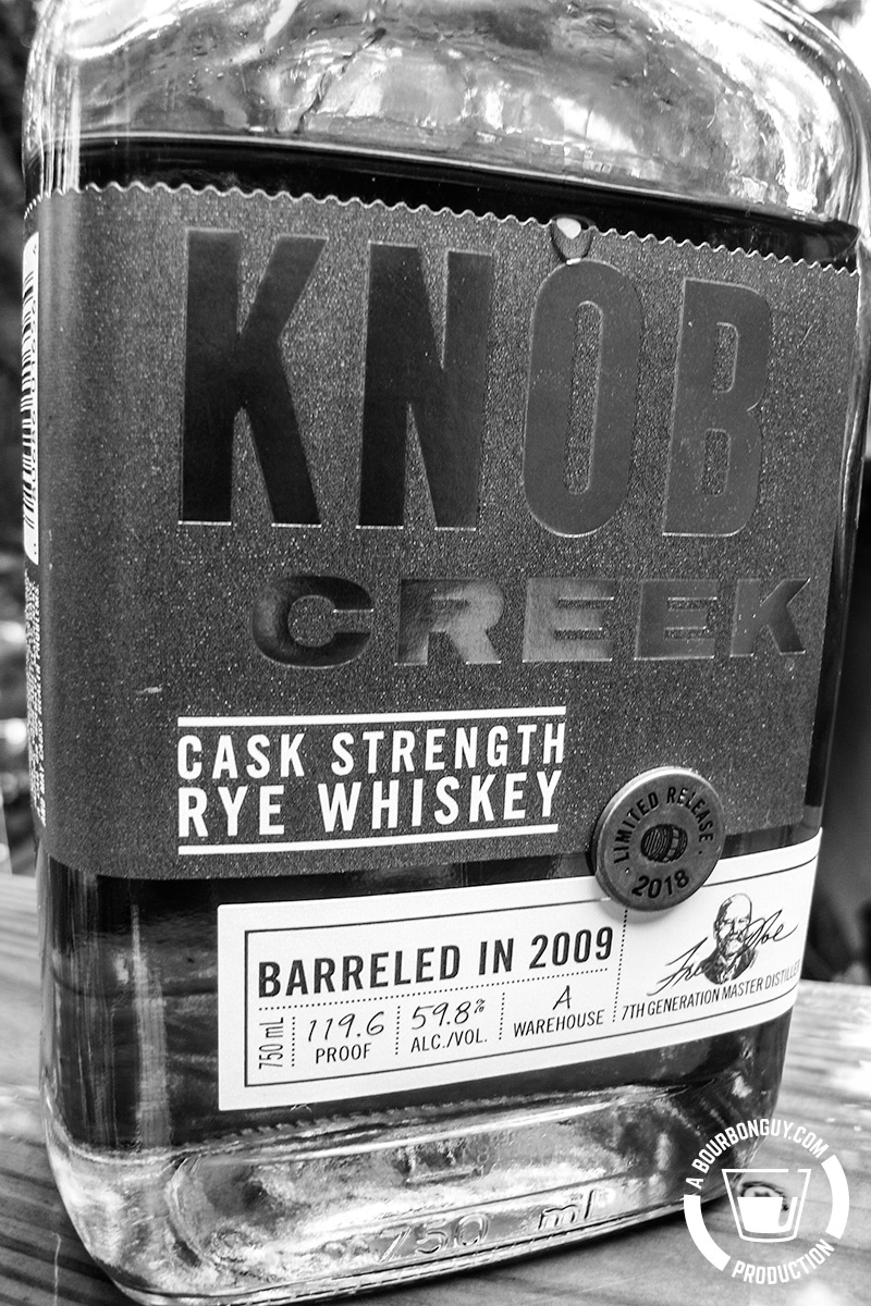 IMAGE: the front label of a bottle of Knob Creek Cask Strength Rye Whiskey.