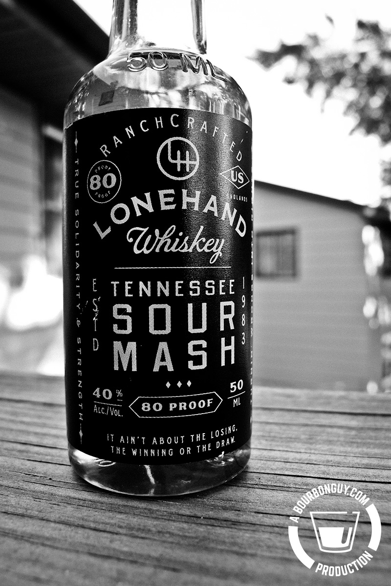 IMAGE: A round 50 mL bottle of Lonehand Tennessee Whiskey.
