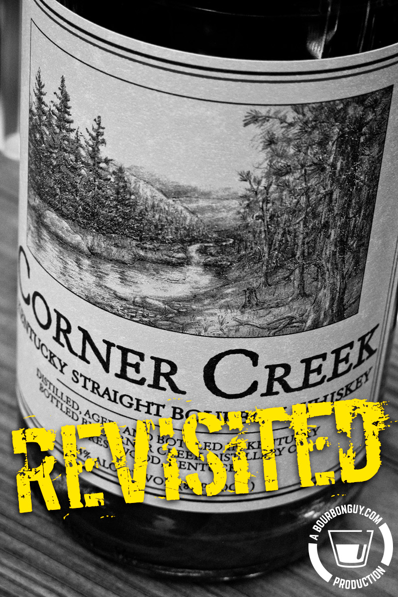 "IMAGE: The label of Corner Creek Bourbon, which features an engraving of a stream running through hills and trees. Superimposed over the image is the word ""Revisited."""