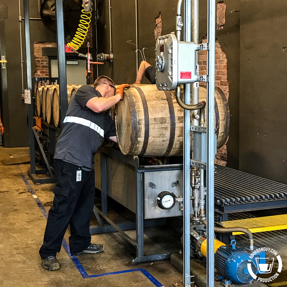 IMAGE: Barrels being dumped at Angel's Envy Distillery