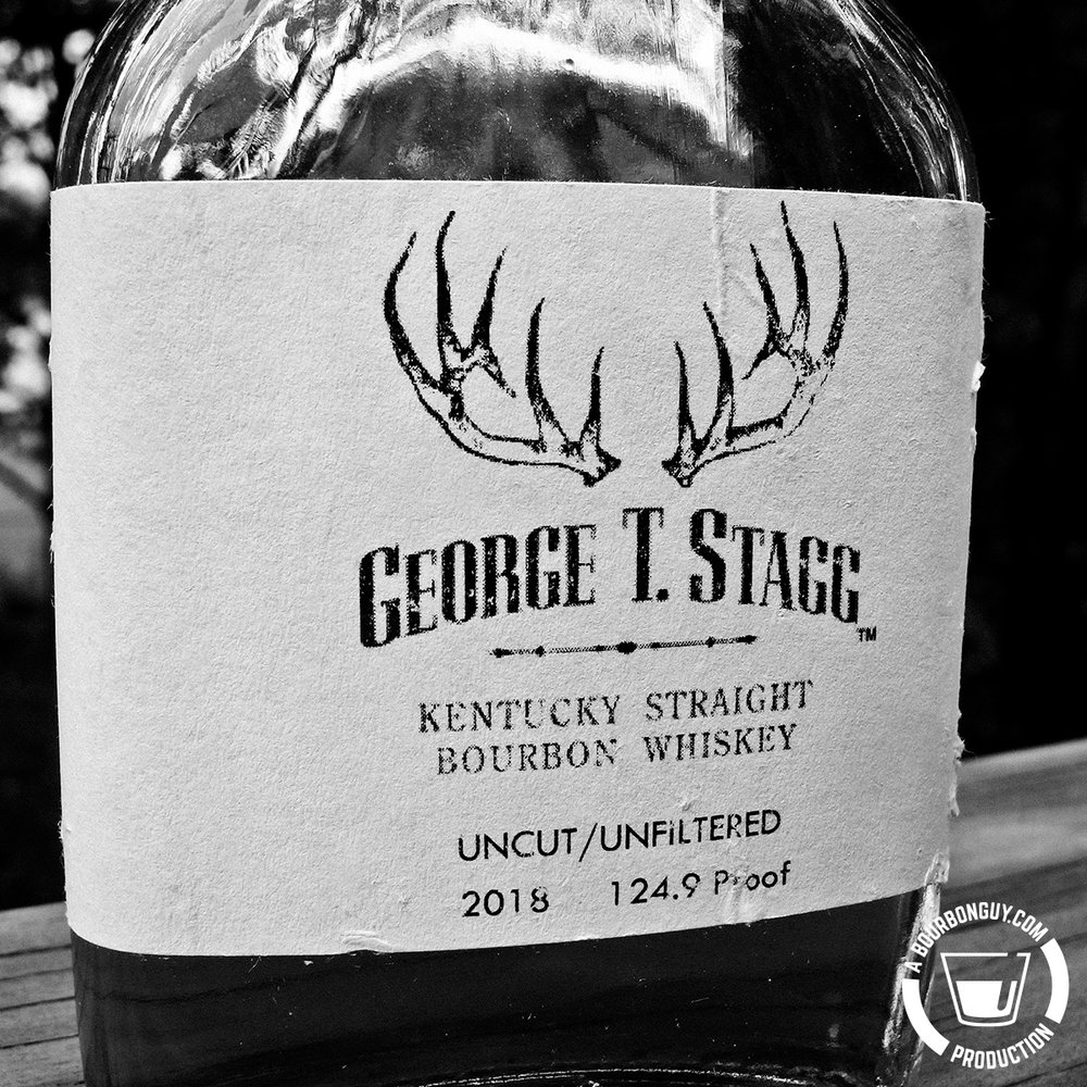 IMAGE: Close up of the label of the sample of George T. Stagg. The label is torn. It has the Stagg logo and the words: Uncut/Unfiltered, 2018, and 124.9 Proof.