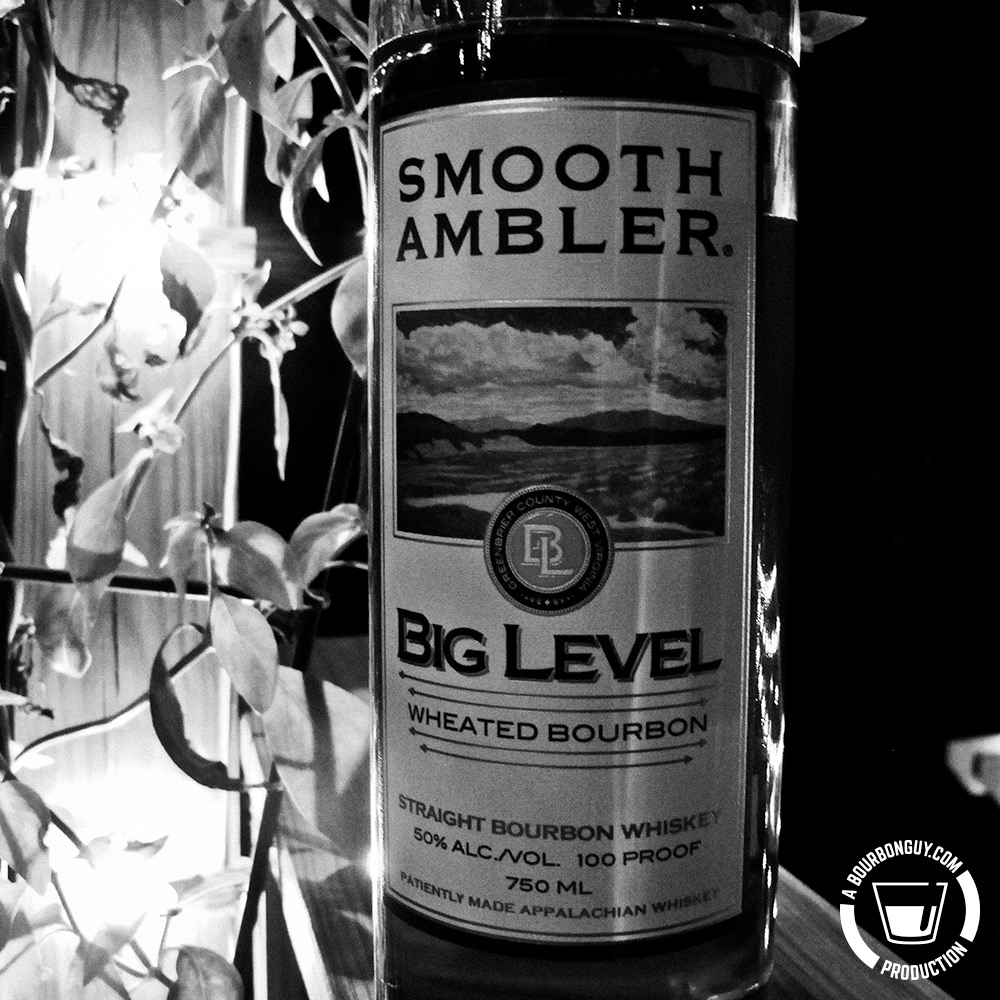 IMAGE: nighttime shot of a bottle of Smooth Ambler's Big Level wheated bourbon.