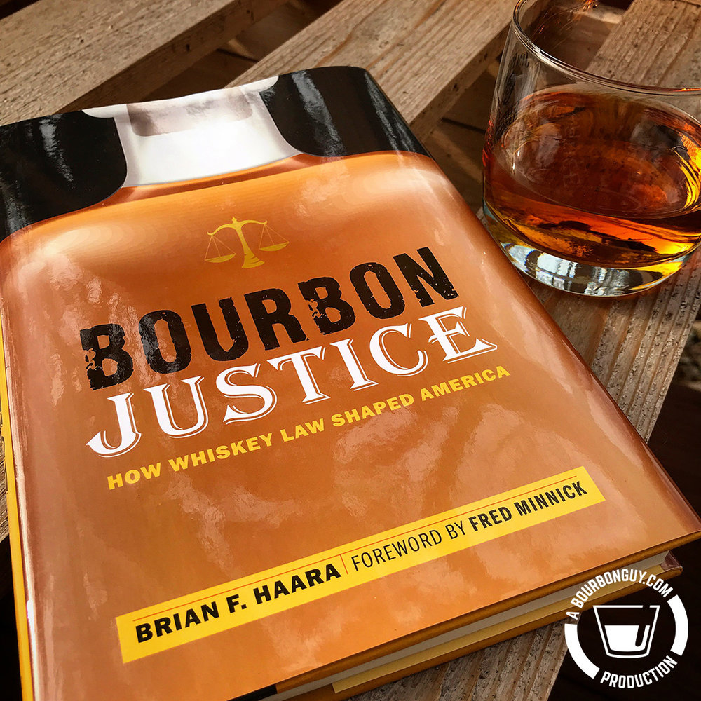 IMAGE: A copy of  Bourbon Justice: How Whiskey Law Shaped America  by Brian Haara and a glass of bourbon to enjoy with it.