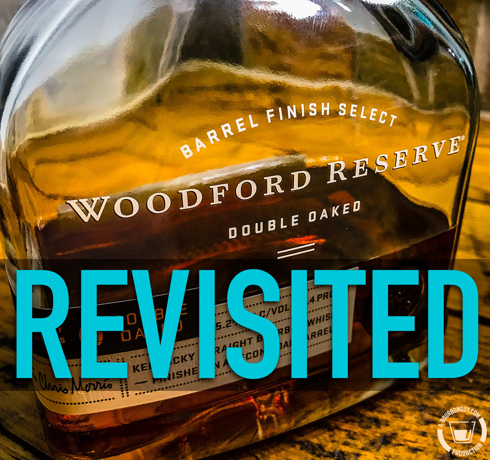 "IMAGE: a new bottle of Woodford Reserve Double Oaked with the tagline ""Revisited"" superimposed over it."