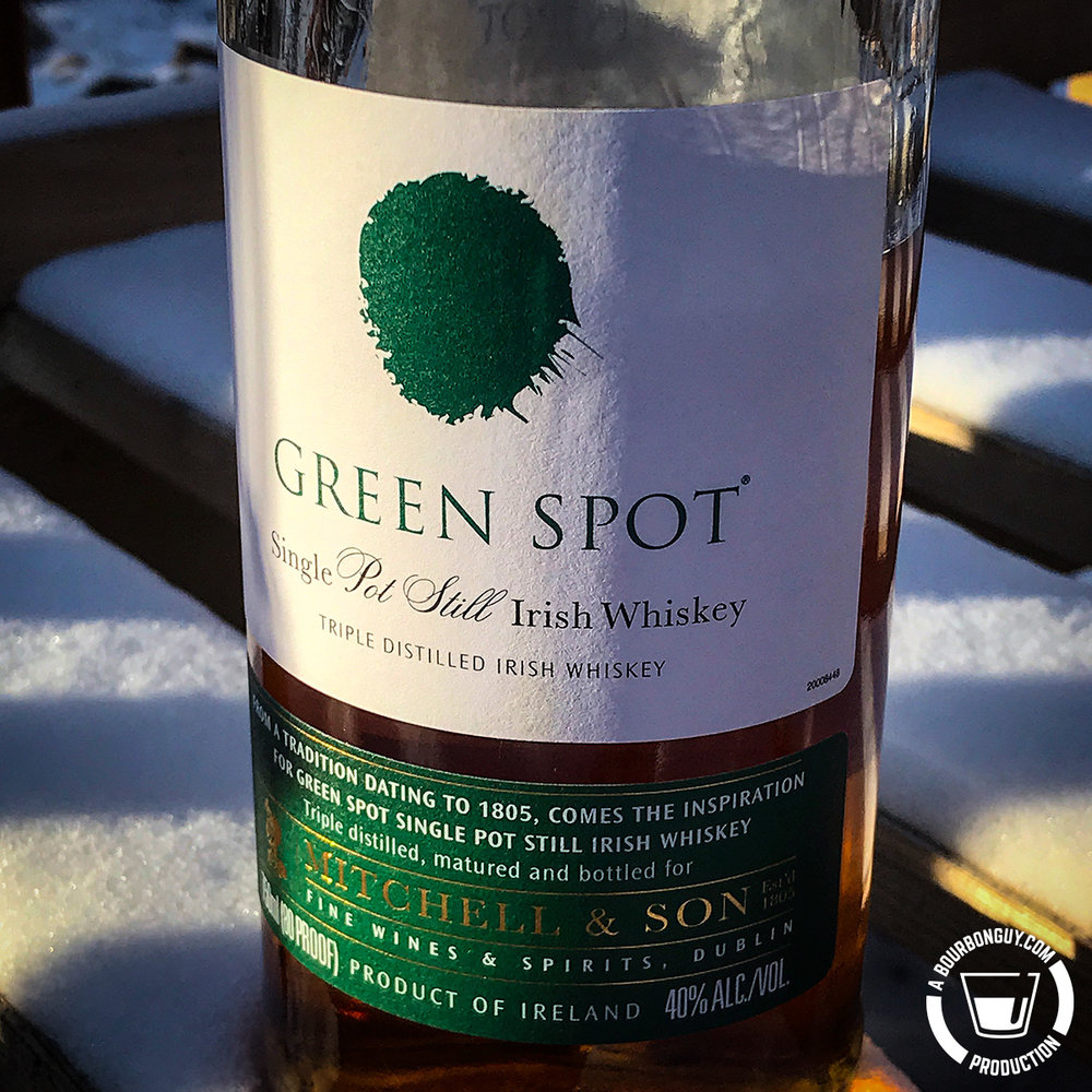 IMAGE: A bottle of Green Spot Irish Whiskey sitting in the snow