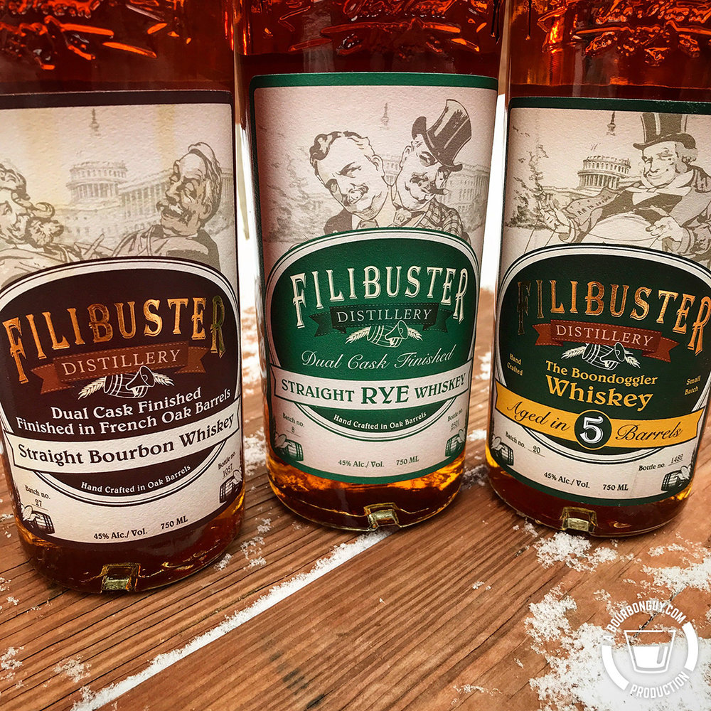 IMAGE: Three bottles of whiskey, a bourbon, a rye and a blend of the two. All from Filibuster Distillery in Virginia