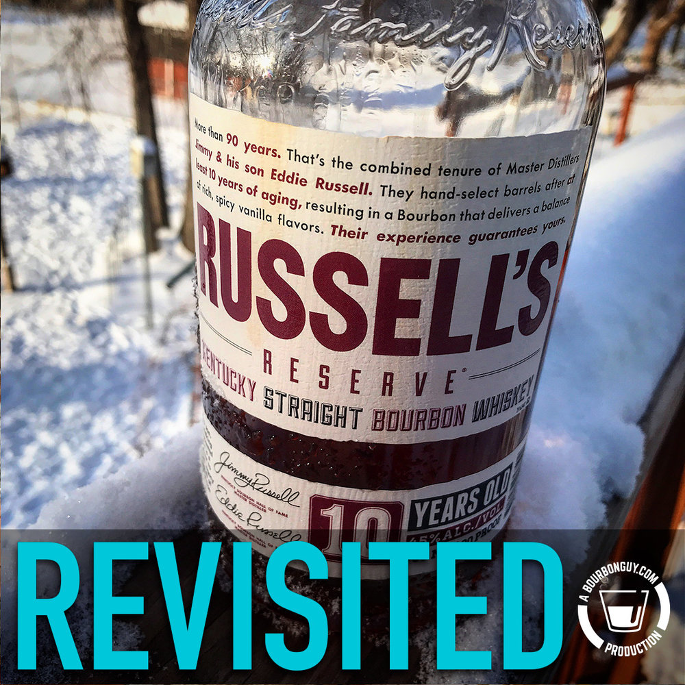 IMAGE: A Bottle of Russell's Reserve 10 year old bourbon sitting in some snow.