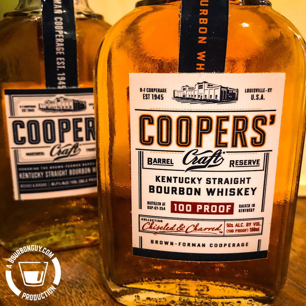 IMAGE: Two sample bottles of Cooper's Craft Bourbon. The one in front is the new 100 proof Barrel Reserve release