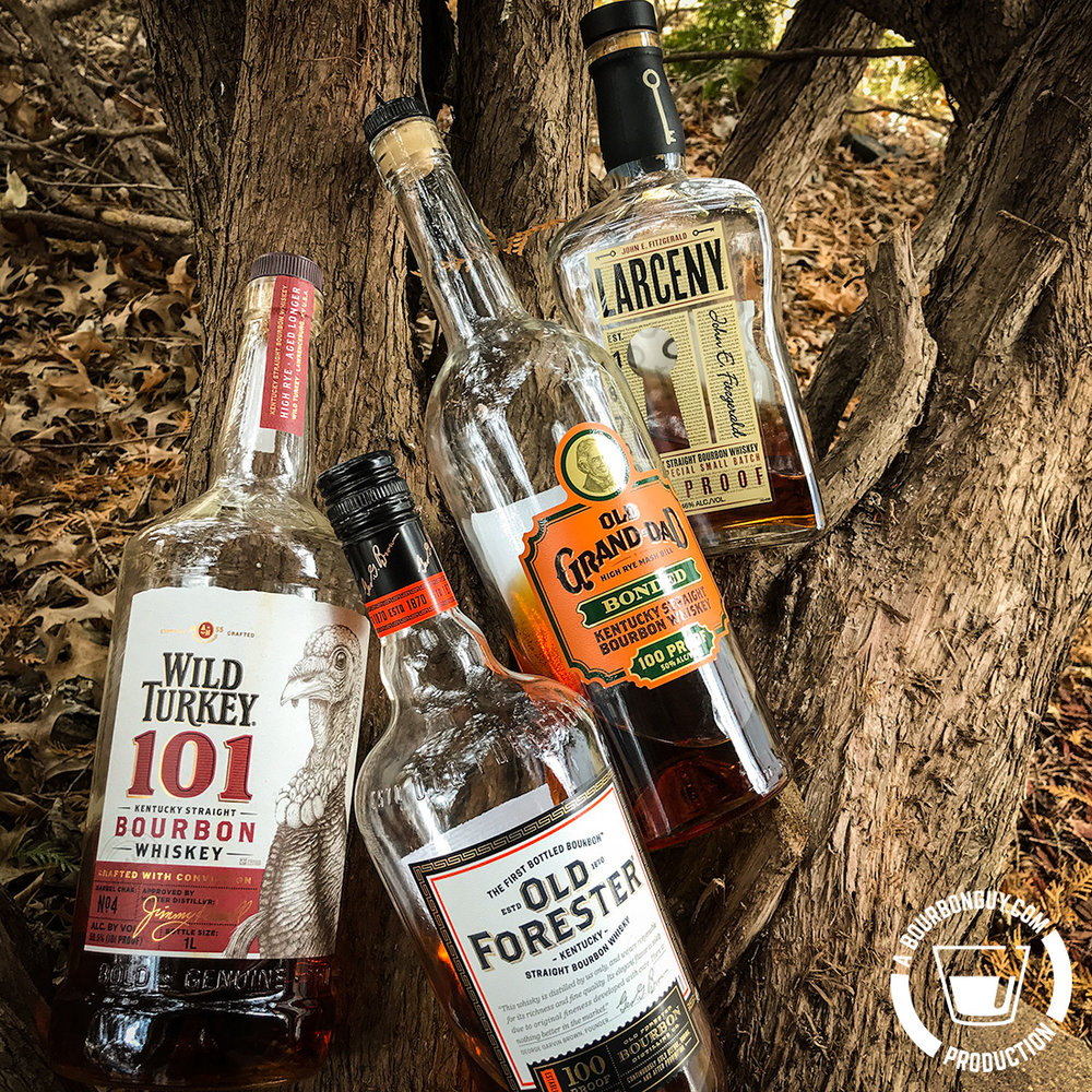 IMAGE: bottles of Wild Turkey 101, Old Forester Signature, Old Grand-Dad Bonded and Larceny sitting in a tree.
