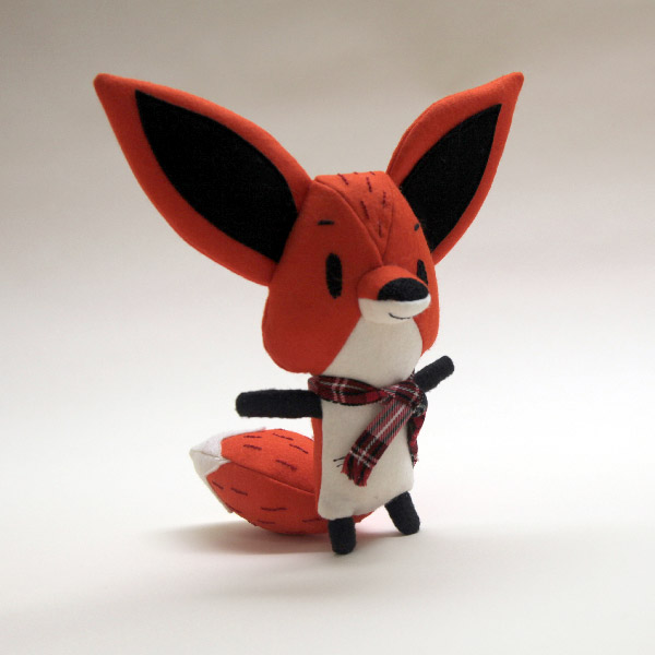 Here is a little fox that I made, he has embroidered features.