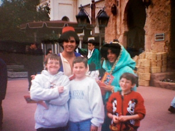 My brothers and me with Aladdin and Jasmine in Disney World.