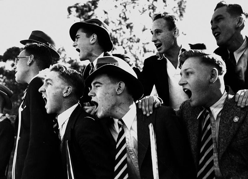 StateLibQld_2_201203_Cheering_schoolboys,_possibly_at_a_sporting_event,_1940-1950.jpg