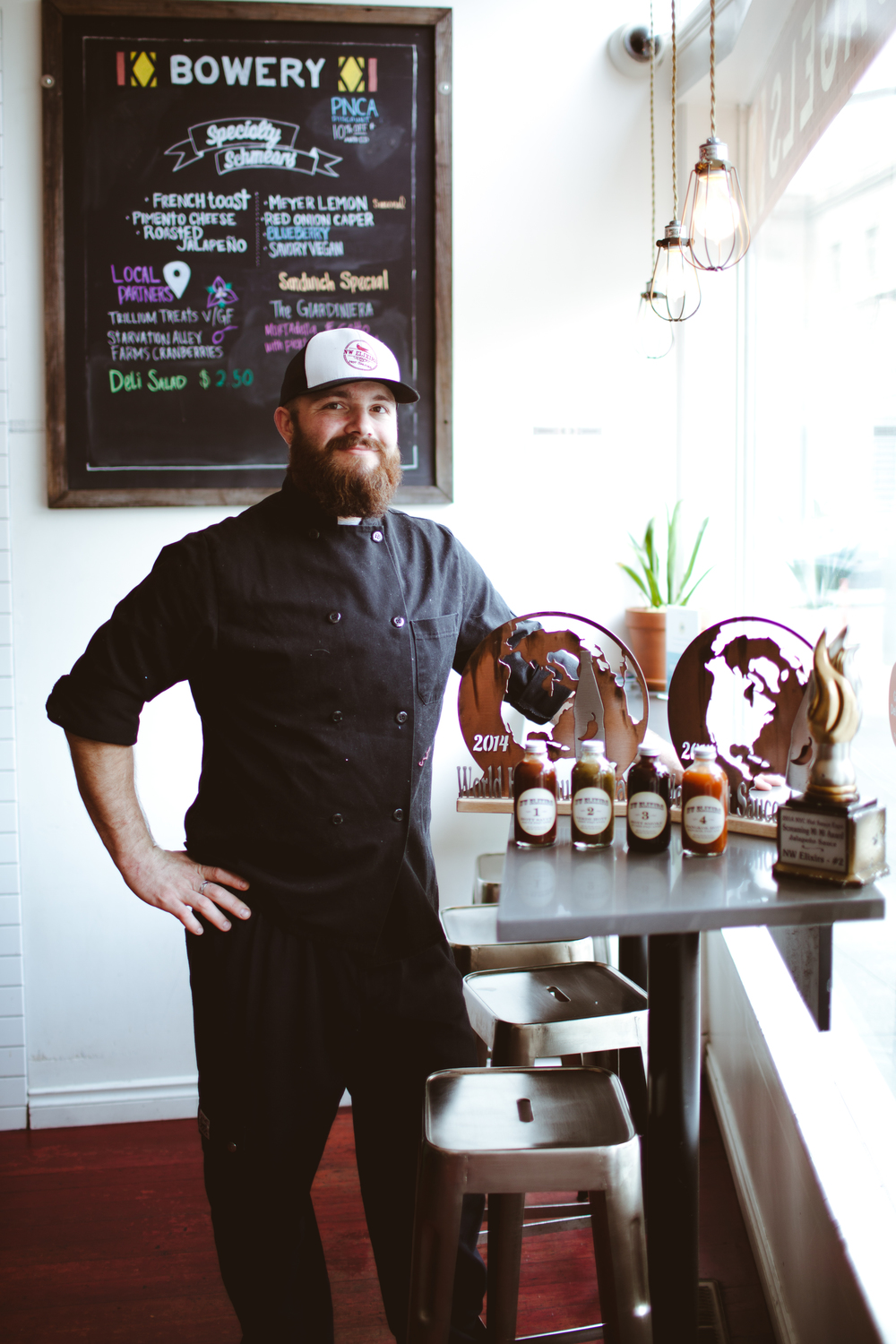 Chef Andrew Garrett with his World Hot Sauce and Screaming Mimi Awards.