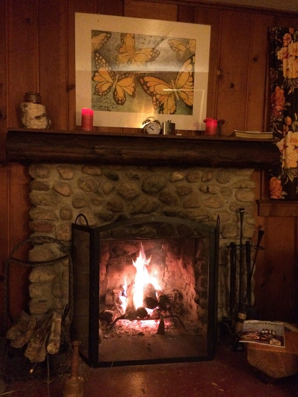 Cosy fireplace in our cabin.