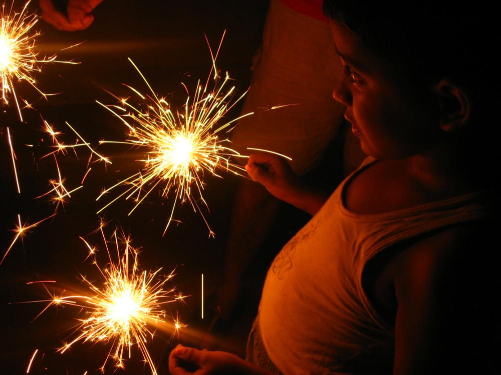 Boy_with_sparklers_-_Diwali.jpg