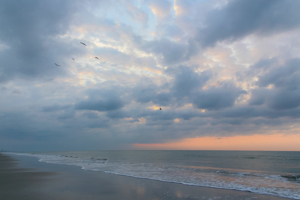 Waking up early with all 3 ofmy sisters in Myrtle Beach to watch the sunrise together, bundled up and hugging in our hoodies - April 2013