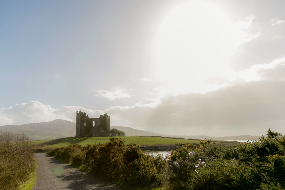 The 'haunted' castle that we trespassed to get to and immediately following this photo I dropped my camera and broke my only lens for the trip - Ireland 2015