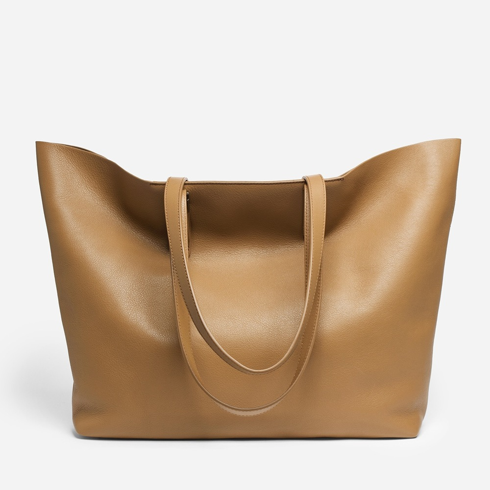 Everlane Petra Market Bag in Camel ($365). I love the size, shape and color of this bag.