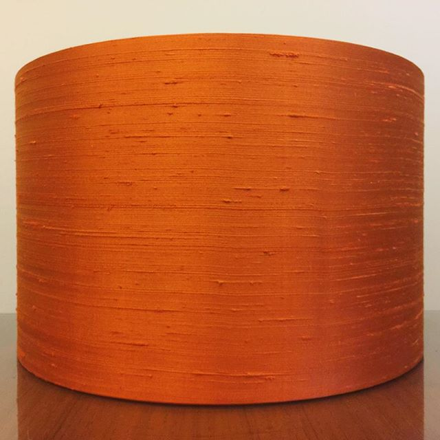"Custom 16"" D x 12"" H lampshade for a customer in 'Orange' Indulgence Silk from @zepelfabrics then lined on the inside with a black linen #itsbeenawhile . . #lampshades #lampshade #customlampshades #lighting #decor #homedecor #design #interiordesign #textiles #handmade #australianmade #custom #silk #orange #black #zepel #linen #redfern #grahamandgraham"