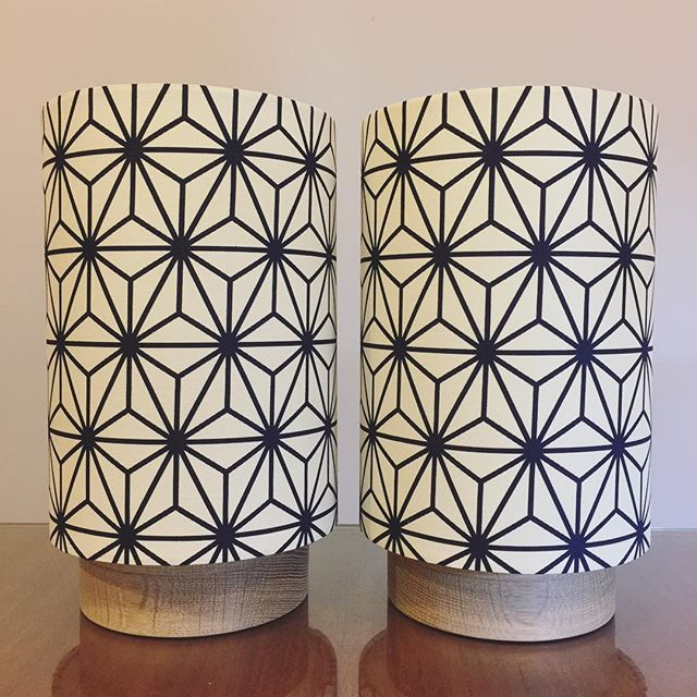 "A pair of custom G&GD 'Little Halo' lamps for a customer in a navy and cream Japanese geometric fabric we bought in Tokyo. Paired with raw American Oak timber bases.  Customer decided on 10"" H shades instead of the standard 12"" H. Also made with cotton disc/lid diffusers . . #lampshades #lampshade #customlampshades #lighting #decor #homedecor #design #interiordesign #textiles #handmade #australianmade #custom #littlehalolamp #americanoak #woodturning #japanesefabric #bedsidelamps #redfern #grahamandgraham"