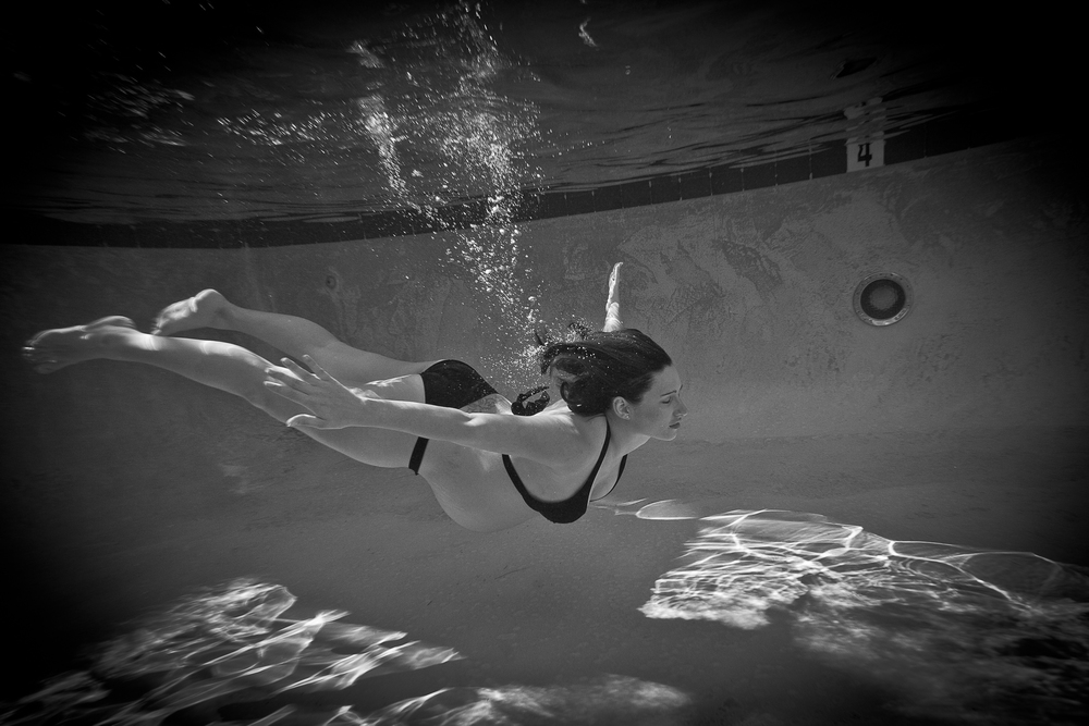 8.5 months pregnant and enjoying the weighlessness and fun of swimming in a pool while I snapped away. Maternity shoot 2013