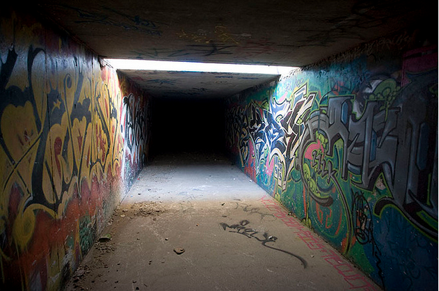 Graffiti adorned walls in a normally pitch black tunnel system under Caesars Palace, Las Vegas