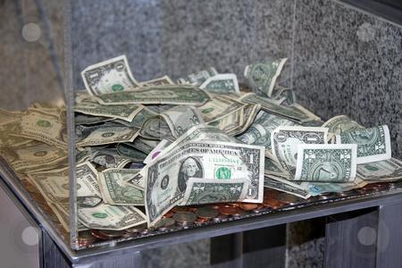 cutcaster-photo-100823225-money-in-a-donation-box