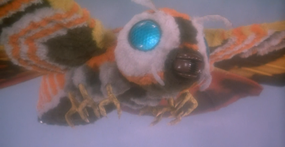 Our fuzzy monster-hero Mothra, swooping in to do battle