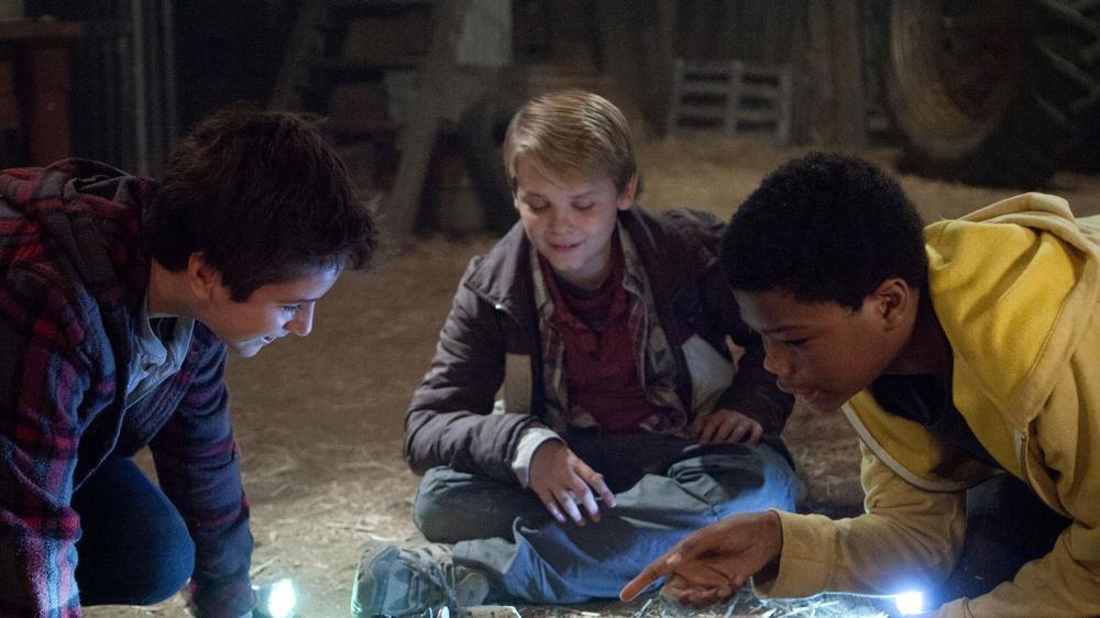 The main trio gathering around their new-found mystery friend.